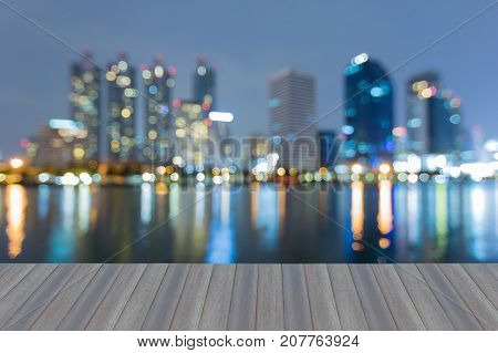 Opening wooden floor Reflection blurred bokeh light office building at twilight abstract background