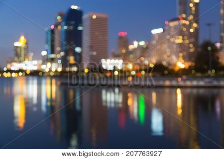 Night blurred bokeh water reflection office building abstract background