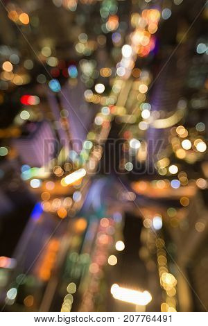 Top view blurred bokeh light city downtown night view abstract background