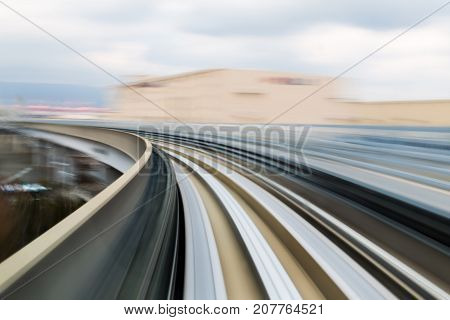 Abstract moving train motion blurred curved skyline abstract background