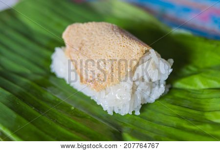 egg custard with sticky rice on banana leaf Thai dessert.