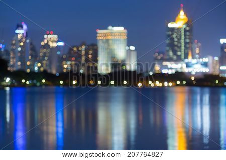 Twilight blurred bokeh office building with reflection abstract background