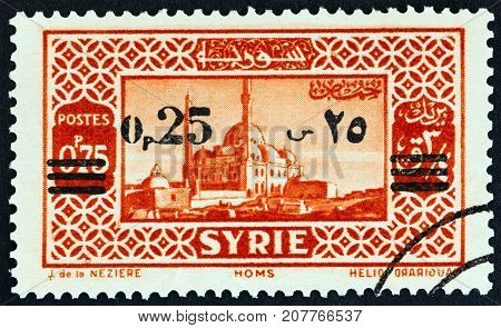 SYRIA - CIRCA 1938: A stamp printed in Syria shows Homs, circa 1938.