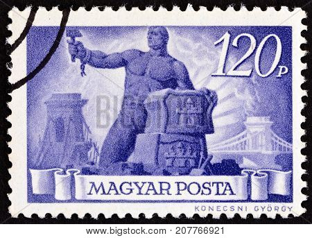 HUNGARY - CIRCA 1945: A stamp printed in Hungary shows Reconstruction, circa 1945.