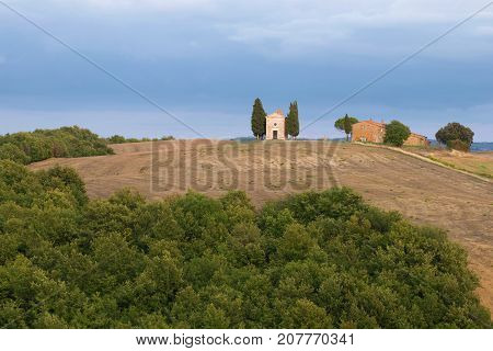 View of the Chapel of Our Lady of Vitaleta on the evening of September. Tuscany, Italy
