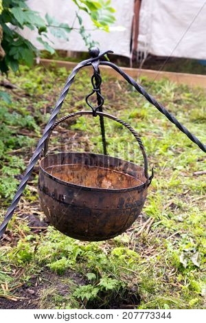 cauldron with a tripod outdoors . In the park in nature