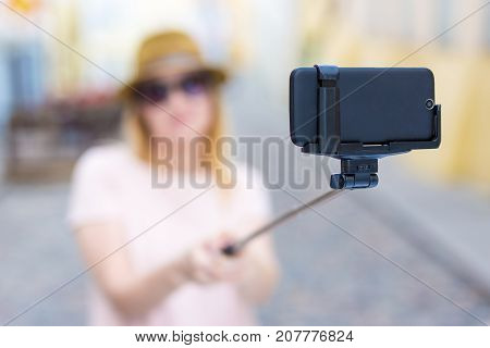 Travel And Photography Concept - Young Woman Tourist Taking Selfie Photo With Smart Phone