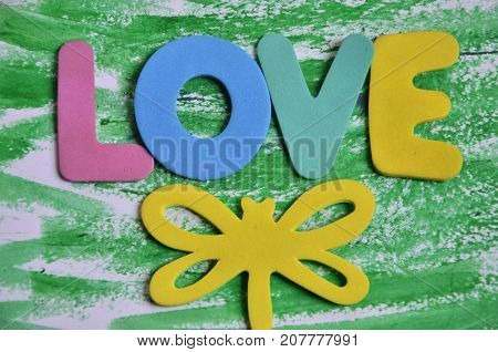 the word love on a  abstract colored background