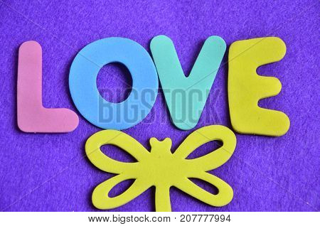 the word love on a  abstract blue background