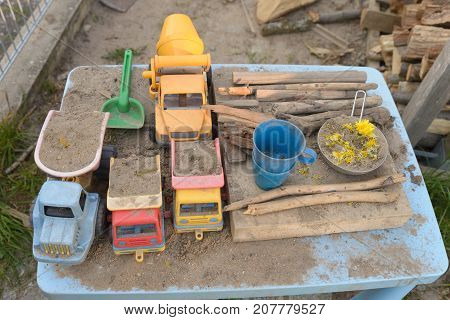 mud work of art build with sand mud and with sand toys
