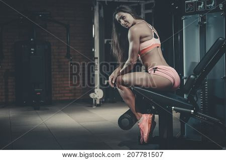 Sexy Athletic Young Girl Training Legs In Gym