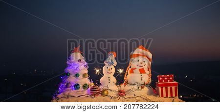 Christmas Night, Mountains With Snowmen Wish Merry Christmas And Happy New Year. Family Holiday In M