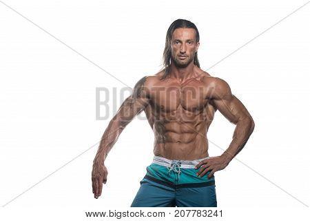 Muscular Bodybuilder Man Posing Over White Background