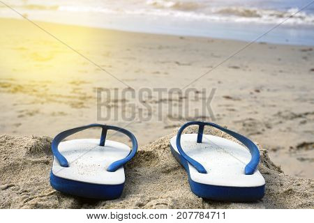Beach Sandals On The Sandy Coast.