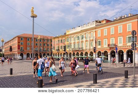 Place Massena is the largest and most spectacular square of Vieux Nice bordered by buildings with impressive red facades - Nice, France, 8 July 2013