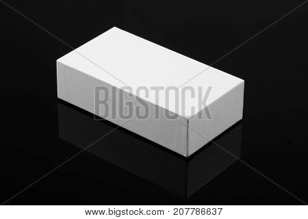 White Box for Mockup on Black Background with reflection