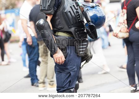 Police officer on duty at a street protest. Law enforcement. Counter-terrorism.