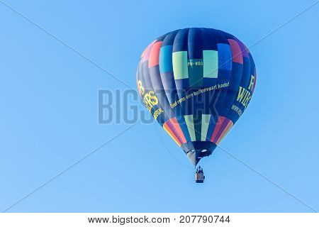 Utrecht Netherlands - 23 September 2017: a hot airballoon in clear blue sky in the Netherlands