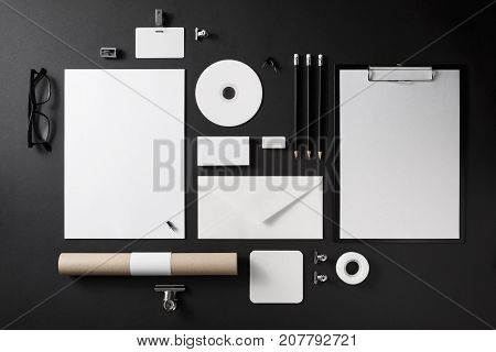 Photo of blank stationery set on black background. Corporate identity mock up for placing your design. Top view.
