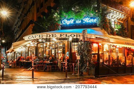 Paris, France-October 05, 2017: The famous cafe de Flore located at the corner of boulevard Saint Germain and rue Saint Benoit. It was once home to intellectual stars , from Hemingway to Pablo Picasso.