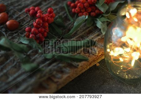 Rowan on a wooden background with a twine