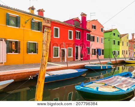 Burano Island. Colorful houses and boats on channels of island. Venice, Italy