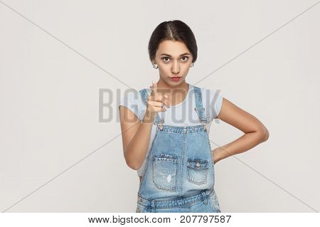 Warning Sign. Young Adult Middle Eastern Woman, Looking At Camera With Serious Face And Finger Warni