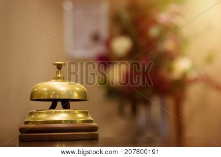 Vintage Bell call service close-up on blur Background. Hotel Concierge. Service bell at the reception hotel