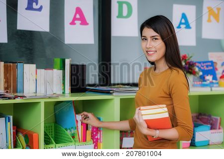 Teacher prepare book for teach student in preschool education job occupation concept