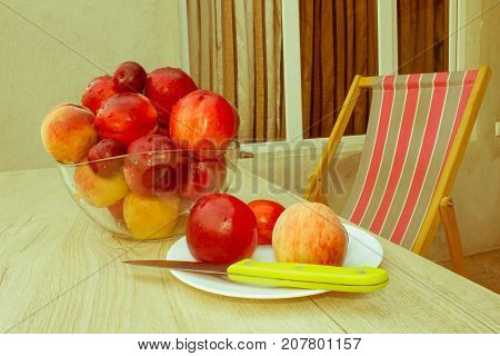 Ripe fruit on the table. Peaches nectarine plums. Beautiful sweet peaches nectarine and plums - Retro color