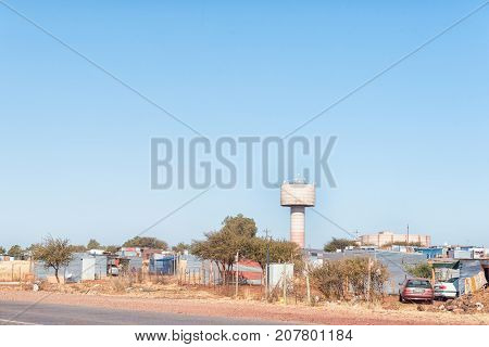 POSTMASBURG SOUTH AFRICA - JULY 7 2017: Informal houses and water reservoirs in Postmasburg a town in the Northern Cape Province of South Africa