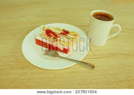 A piece cake on dish with currant in a relaxing time. Piece cake on white plate with fork - Retro color