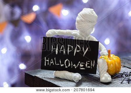 Cute funny mummy. Halloween decoration on table