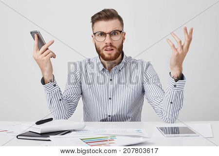 Puzzled Bearded Man With Indignant Look Can`t Understand Why There Is No Answer From Colleague, Gest
