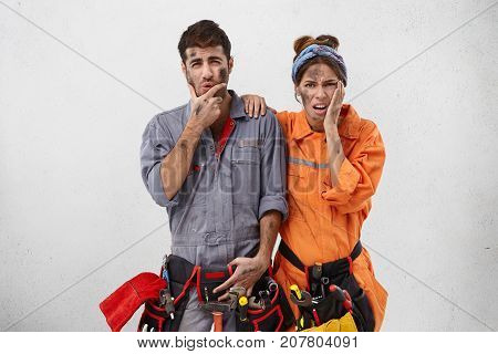 Overworked Unhappy Bearded Repairman And His Female Assistant, Have Dirty Faces, Look In Displeaseme