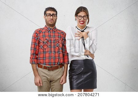 Unhappy Discontent Woman And Man Look With Disgusting Expression, As See Something Unpleasant. Nerd
