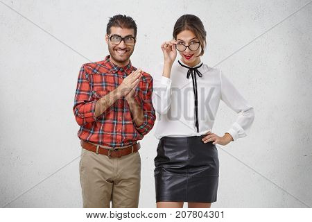 Two Young Teachers In Spectacles Have Intriguing Look, Going To Teach You, Or Give Lesson. Happy Mal