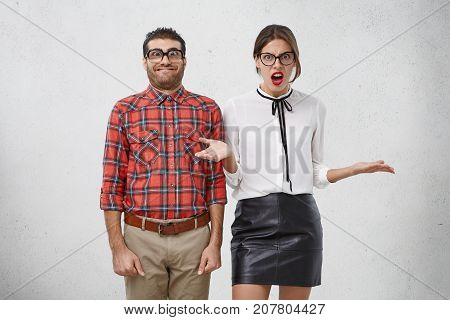 Awkward Funny Unshaven Male Geek Stands Next To Beautiful Female With Red Lips, Doesn`t Know How To