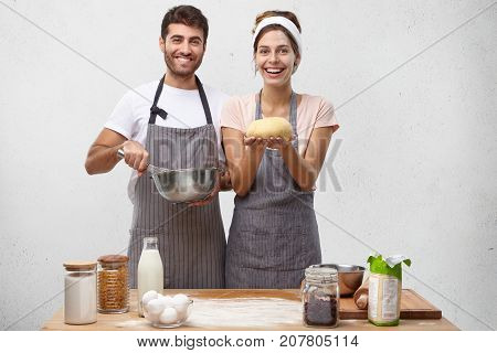 Products, Food, Cuisine And Cooking Concept. Portrait Of Happy Positive Young European Couple Baking