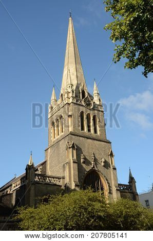 A view of a church tower and spire in London