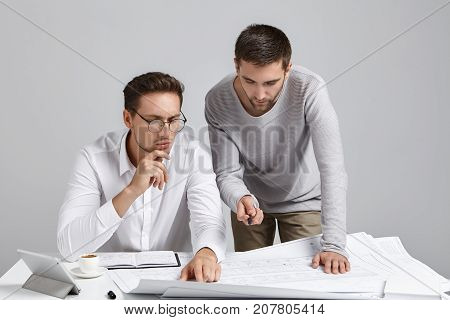 People, Collaboration And Discussion Concept. Professional Architect Coworkers Look Attentively At B