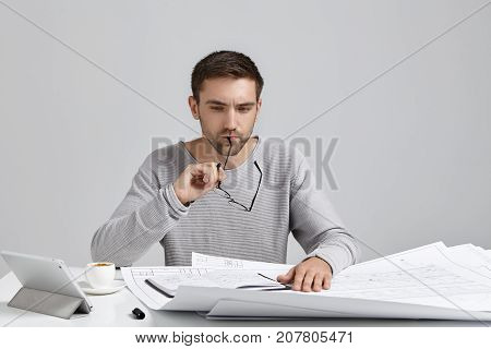 Hard Working Male Designer Takes Off Spectacles, Has Thoughtful Expression, Tries To Concentrate On