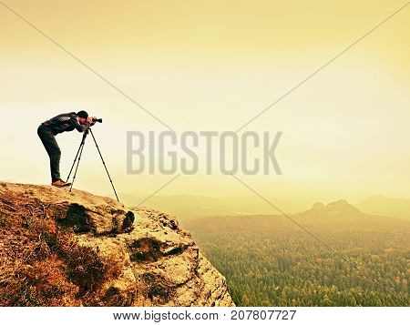 Wildlife Photographer On Mountain Summit Works. Man Like To Travel And Photography, Taking Pictures