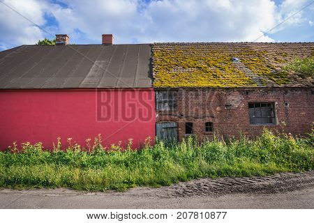 Renovated and ruined buildings in small village Stare Brynki West Pomeranian Voivodeship in Poland