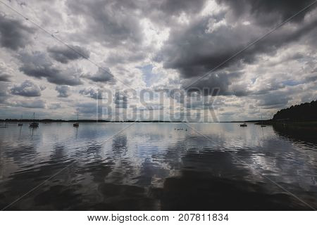 Clouds reflected in Miedwie Lake in Morzyczyn town near Stargard in Poland