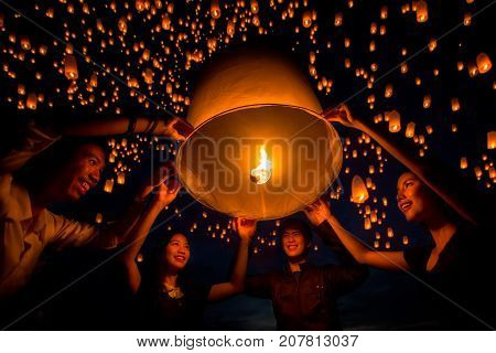 friend group enjoy yeepeng festival togather in Thailand Yee peng is balloon and fire and very faver to play in asia such as Thailand China and Taiwan