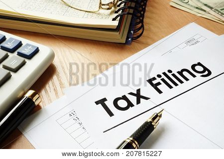 Papers with title Tax filing on an office desk.