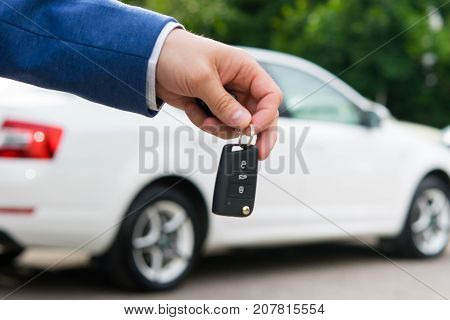 transfer of a car to a new owner for money ignition keys in the manager's hand