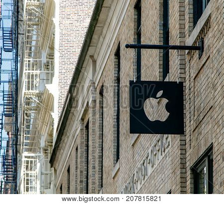 New York September 25 2017: Apple Company logo is suspended above the entrance to their store in SoHo.