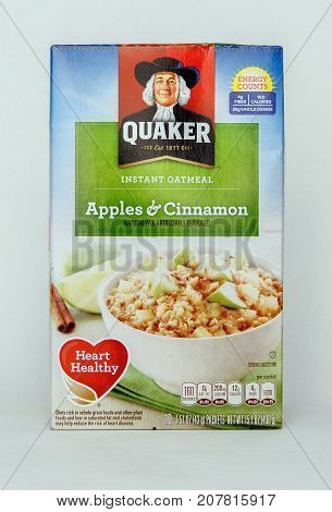 New York September 17 2017: Pack of Quaker instant oatmeals stands against white background.